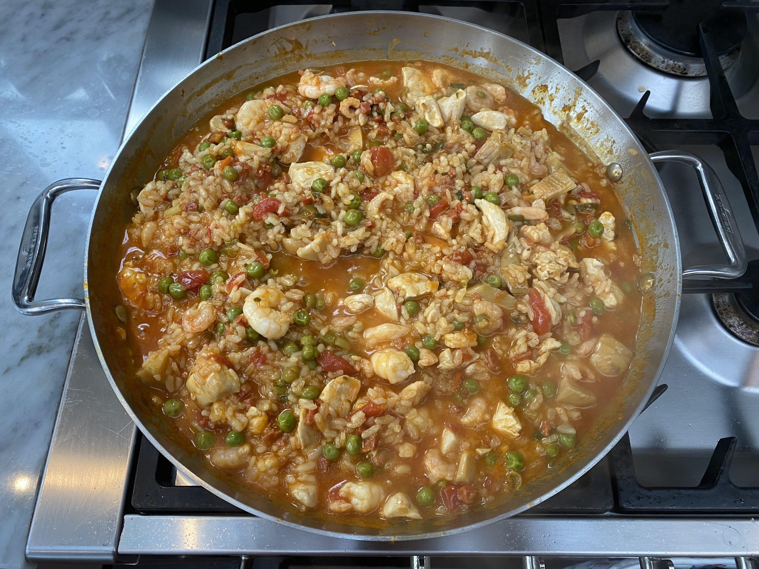 Paella with Chicken, Chorizo & Prawns with a superb Spanish red wine